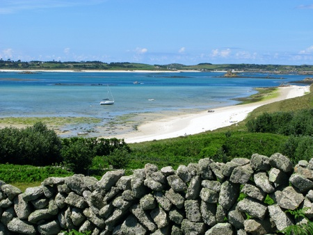 scilly: St Martins dry stone wall and middle town beach, Isles of Scilly. Stock Photo