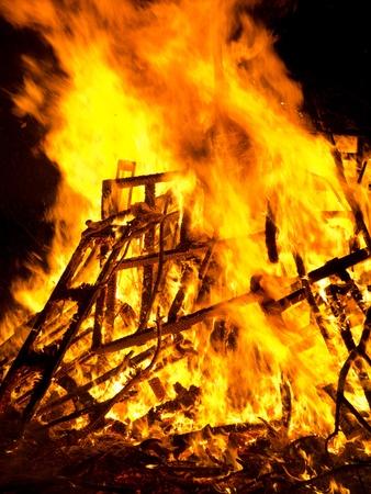 Bright burning wood outside bonfire flames.