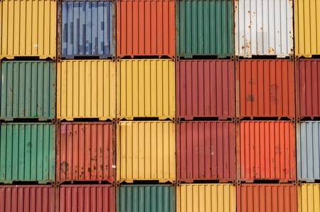 old container: Colorful ship cargo containers stacked up in a port.