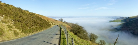 Panorama narrow road Welsh hills morning mist, Mynydd Epynt. Stock Photo - 12906725