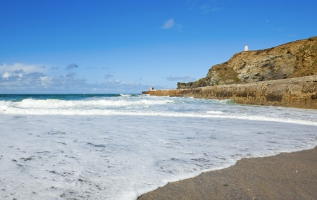 Portreath beach waves breaking, Cornwall UK. photo