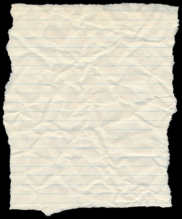yellowing: Old yellowing crumpled lined paper torn edges isolated on black.