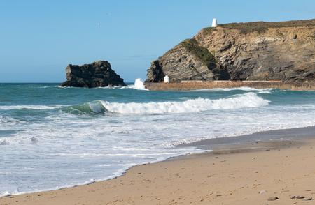 Portreath pier beach shore waves, Cornwall England.