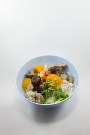 backgruond: gruel pork mushrooms On a blue bowl white backgruond Stock Photo