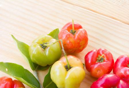 barbados: Barbados cherry on wood Stock Photo