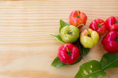 barbados: Barbados cherry on wood background Stock Photo