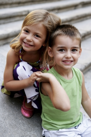 Boy and girl holding hands photo