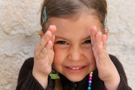 pigtail: Young girl playing a game of peek a boo