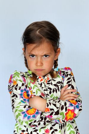 disapproval: Studio portrait of young girl pulling a face to show disapproval Stock Photo