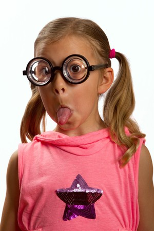 pigtail: Little girl wearing big round glasses and making a silly expression