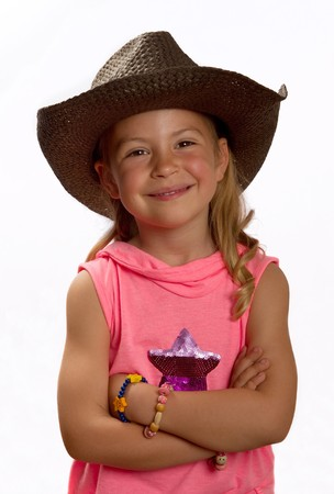 Portrait of a pretty little girl wearing a brown straw hat photo