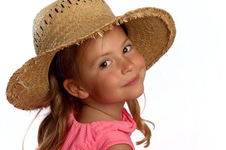Portrait of a pretty little girl wearing a straw hat photo