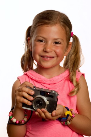 Pretty young girl holding an old camera photo