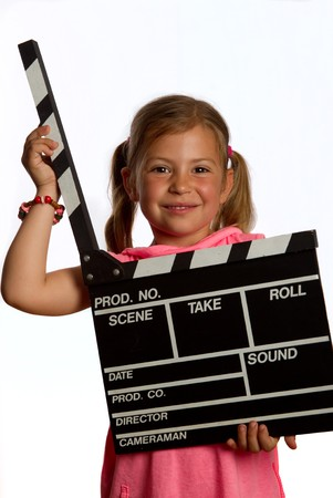 Pretty young girl holding a clapperboard in the open position photo
