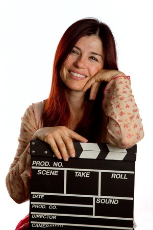 clapboard: Pretty woman resting on a film clapperboard Stock Photo