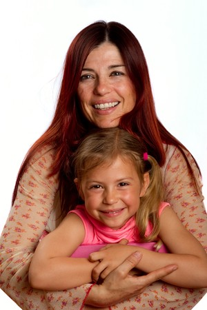 Mother hugging her pretty young daughter and smiling photo