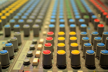 audio mixer: buttons from an audio mixer in a broadcast studio control room