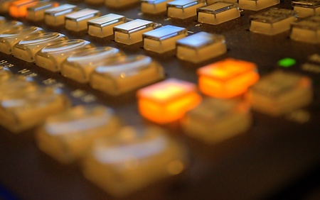 live action: lit buttons on a vision switcher in a TV studio Stock Photo