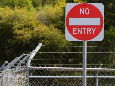 razor wire: Fenced No Entry Sign Stock Photo