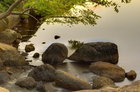 japenese: Japenese garden pool and rocks at evening Stock Photo