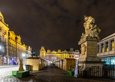 townhouses: Night view of the Easter decorations and Easter Fair stands Poznan at the Poznan Old Market Stock Photo