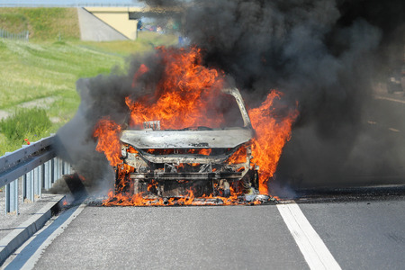 A car burning with thick black smoke Stock Photo