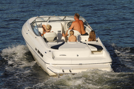 A family on a motorboat cruise