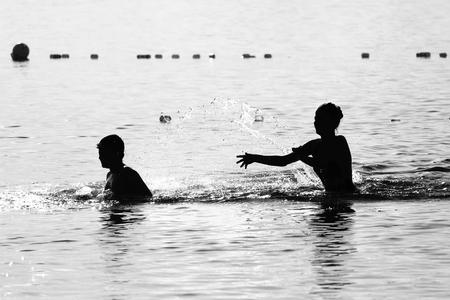 frolicking: Summer holidays concept - children frolicking in lake water