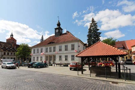 Reszel, Poland on August 29, 2017. The town hall at the main square in summer.