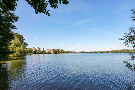The Czos lake and a panorama of Mragowo on a beautiful summer day.