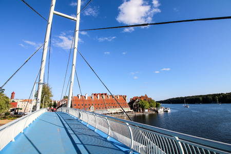 Mikolajki, Poland - August 29, 2017. Pedestrian bridge over the strait connecting Talty and Mikolajskie lakes.