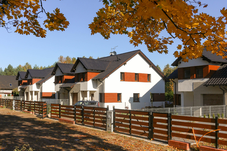 Picturesque newly built houses  suburban housing development on a beautiful autumn day