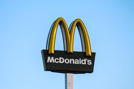 McDonalds company logo with a beautiful blue sky background