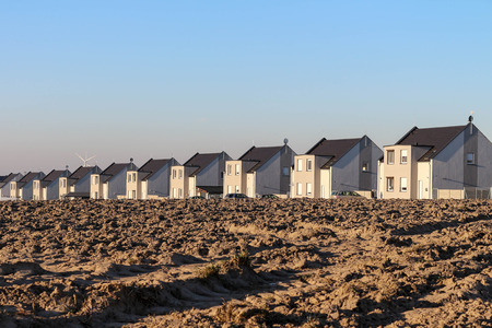 a row of newly built houses  housing development  real estate development in suburban area