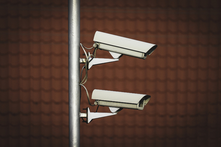 Two CCTV  surveillance cameras mounted on a pole