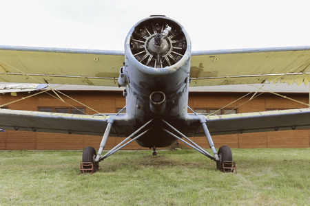 Old biplane aircraft standing in front of the hangar Reklamní fotografie