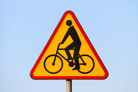 Cyclists - Polish road sign with a blue sky background