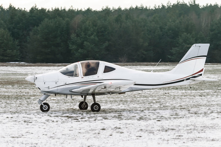 Light, two seat trainer aircraft taxiing for takeoff