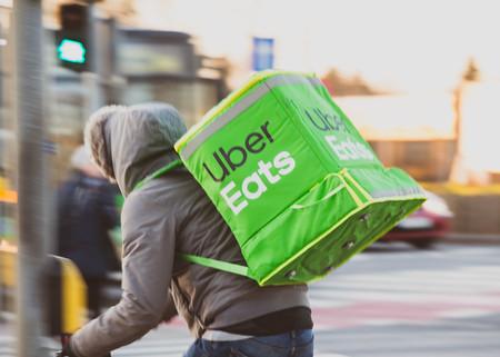 Uber Eats bike messenger riding in city traffic