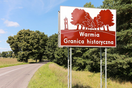 A sign marking the historical region of Warmia