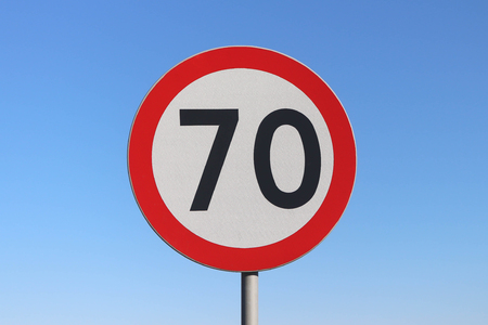 70 km  h speed limit road sign with a blue sky background