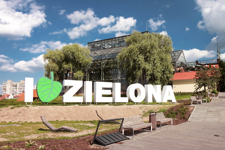 ZIELONA GORA, POLAND - Zielona Gora city advertising slogan with the palm house visible in the background