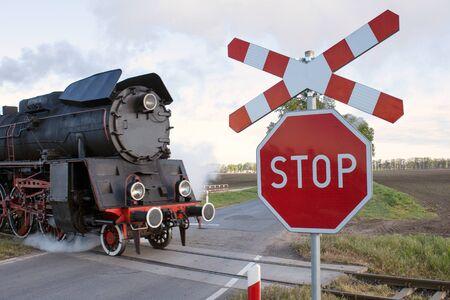 Stop - railway crossing / level crossing road sign