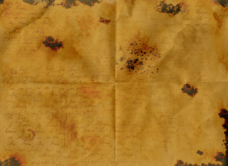 Vintage Stained Burnt Folded Old Paper with Faded Writing