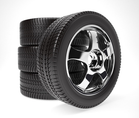 New car wheel with winter tire stacked up and isolated on white background Imagens
