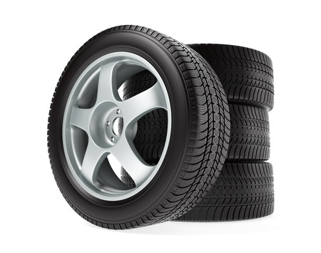 winter road: Car wheel with winter tire stacked up and isolated on white background