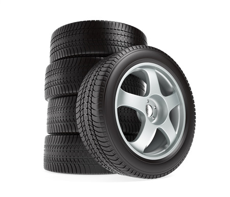 New car wheels with winter tires stacked and isolated on white background