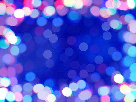 Multicolored bokeh defocused background. Frame of shiny colored confetti, blurred backdrop