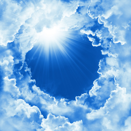 Religion concept of heavenly background with dramatic clouds. Divine shining heaven, light. Sky with beautiful cloud and sunshine. Round frame, religion template, mock up. Peaceful sky background