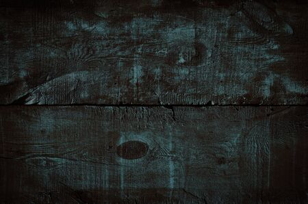 Dark blue wood texture, top view of wooden table. Colored rustic wall background, texture of old top table, gloomy grunge background
